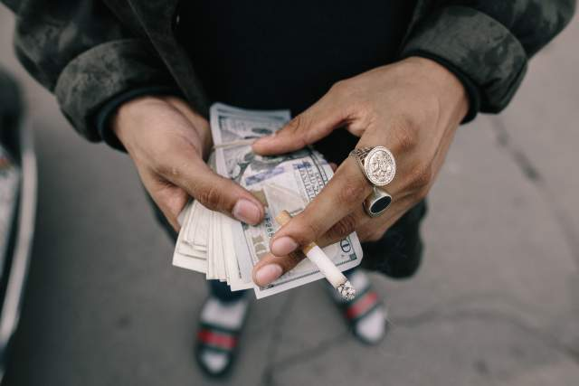 man-counting-money
