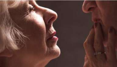 elderly-woman-touching-husbands-lips