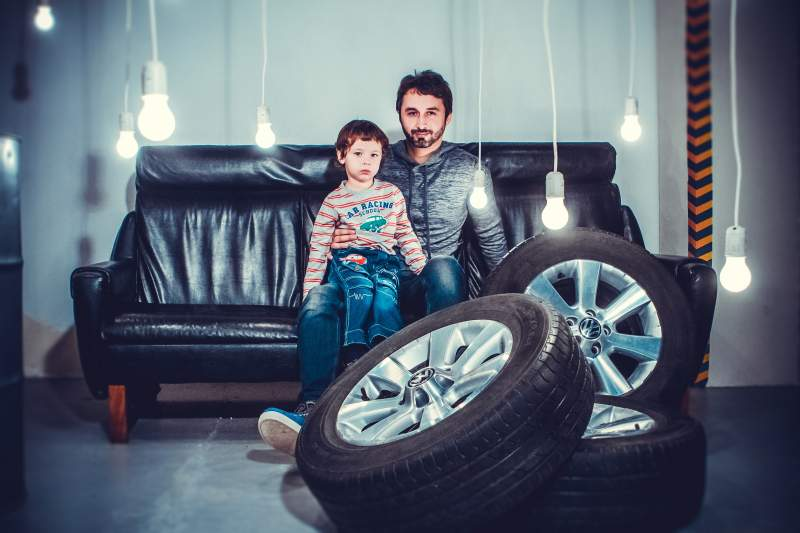 adult-boy-sofa-tyre